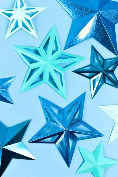 Use your Cricut Scoring Wheel to create these easy 3D paper stars. Perfect for party decorations, nursery decor, and Christmas decorating!