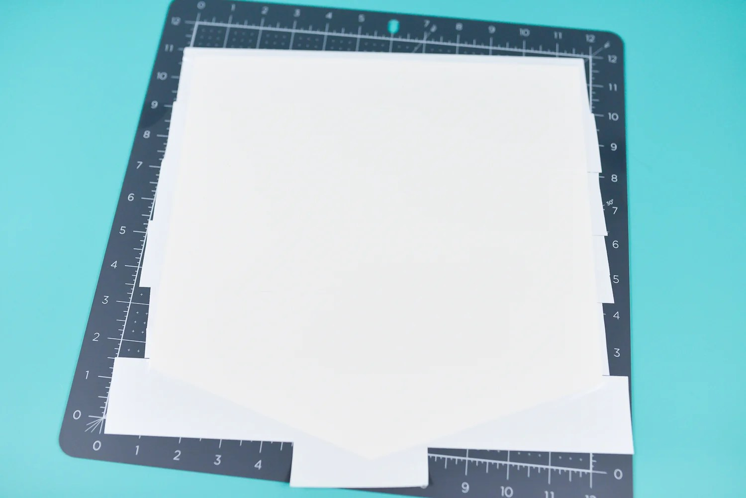 Cover white cardstock with strips of white Duck Tape