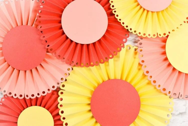 Make these beautiful Paper Rosettes from heyletsmakestuff.com using your Cricut! Pick your favorite colors and add some bridal shower pop.