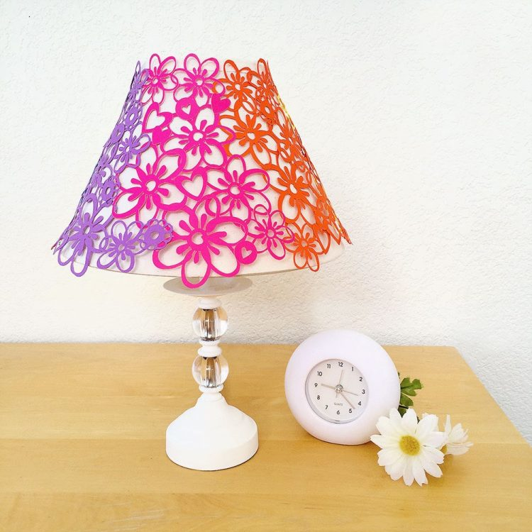 This DIY paper lace rainbow flower lampshade from 100directions.com would look great in any corner of your home that is screaming for a pop of fun color.