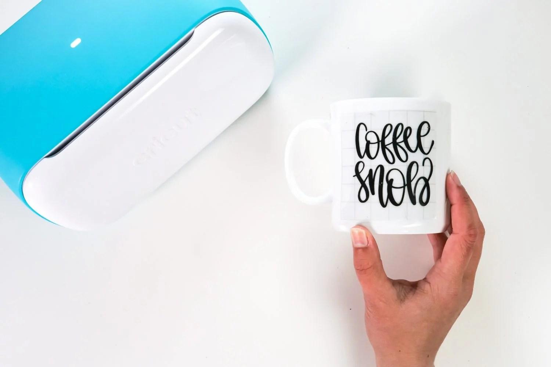 Coffee Snob decal on mug with transfer tape.