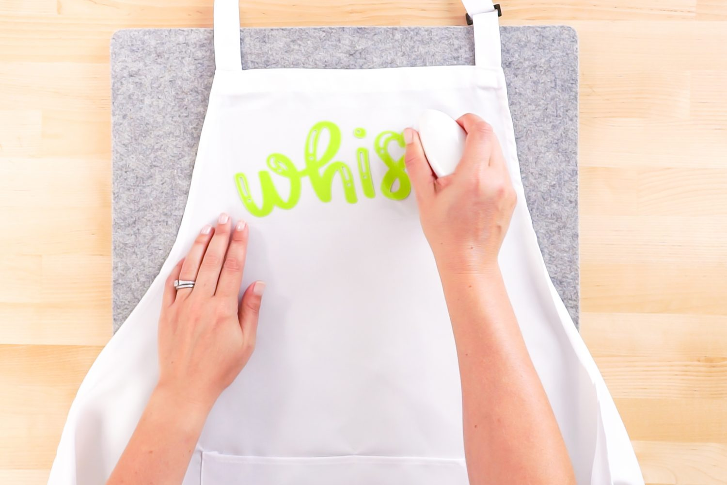 Iron the first layer onto your apron using the EasyPress Mini.