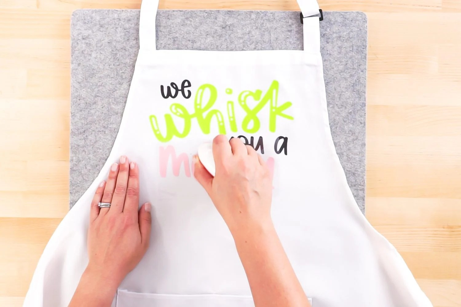 Iron the other layers onto your apron using the EasyPress Mini.