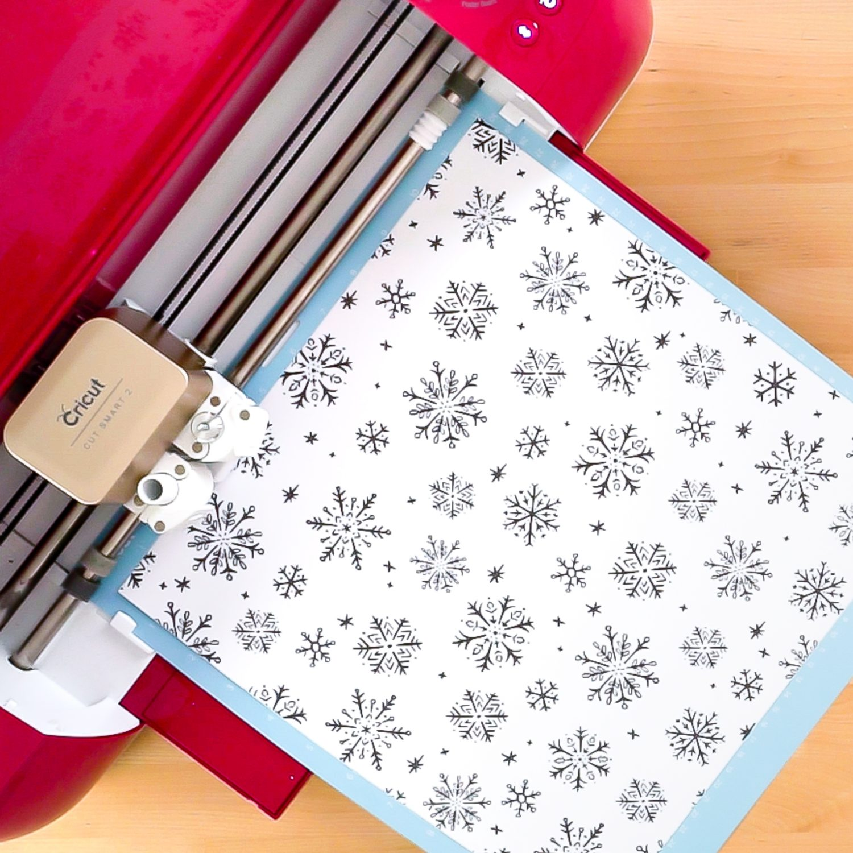 Cricut Explore cutting snowflake scrapbook paper