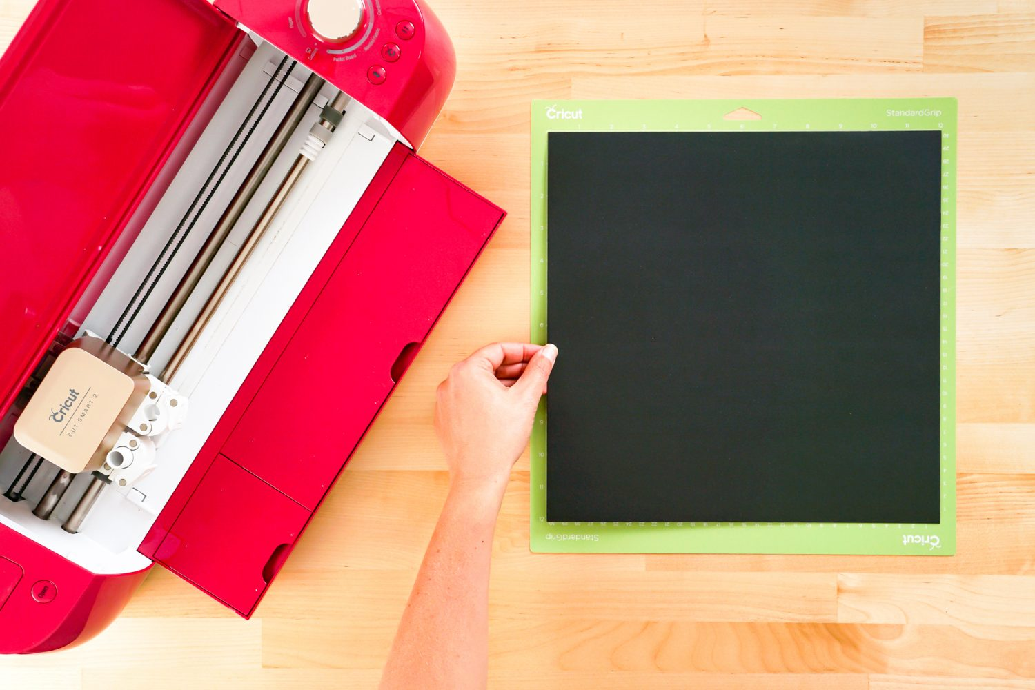 Black cardstock on a cutting mat.