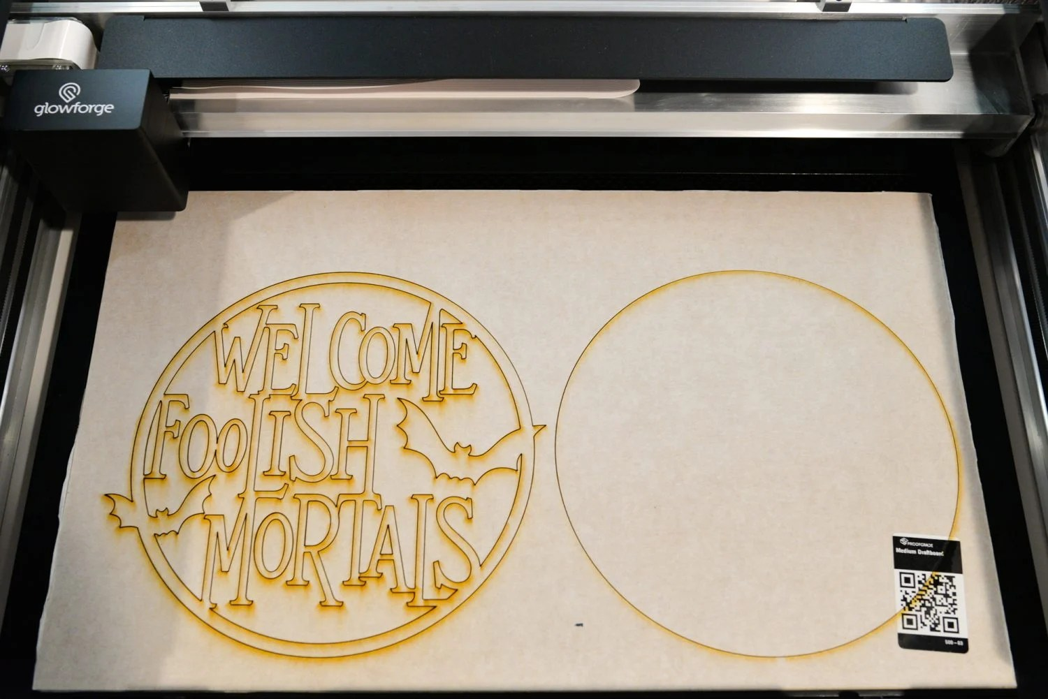Finished Halloween sign in the bed of the Glowforge