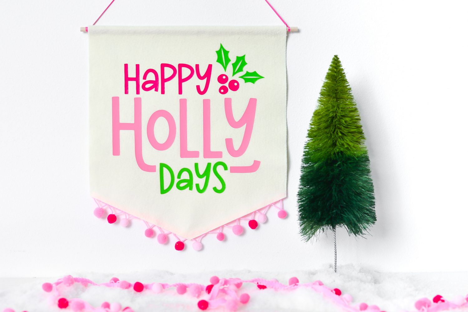 Happy Holidays Banner hanging with Christmas decor