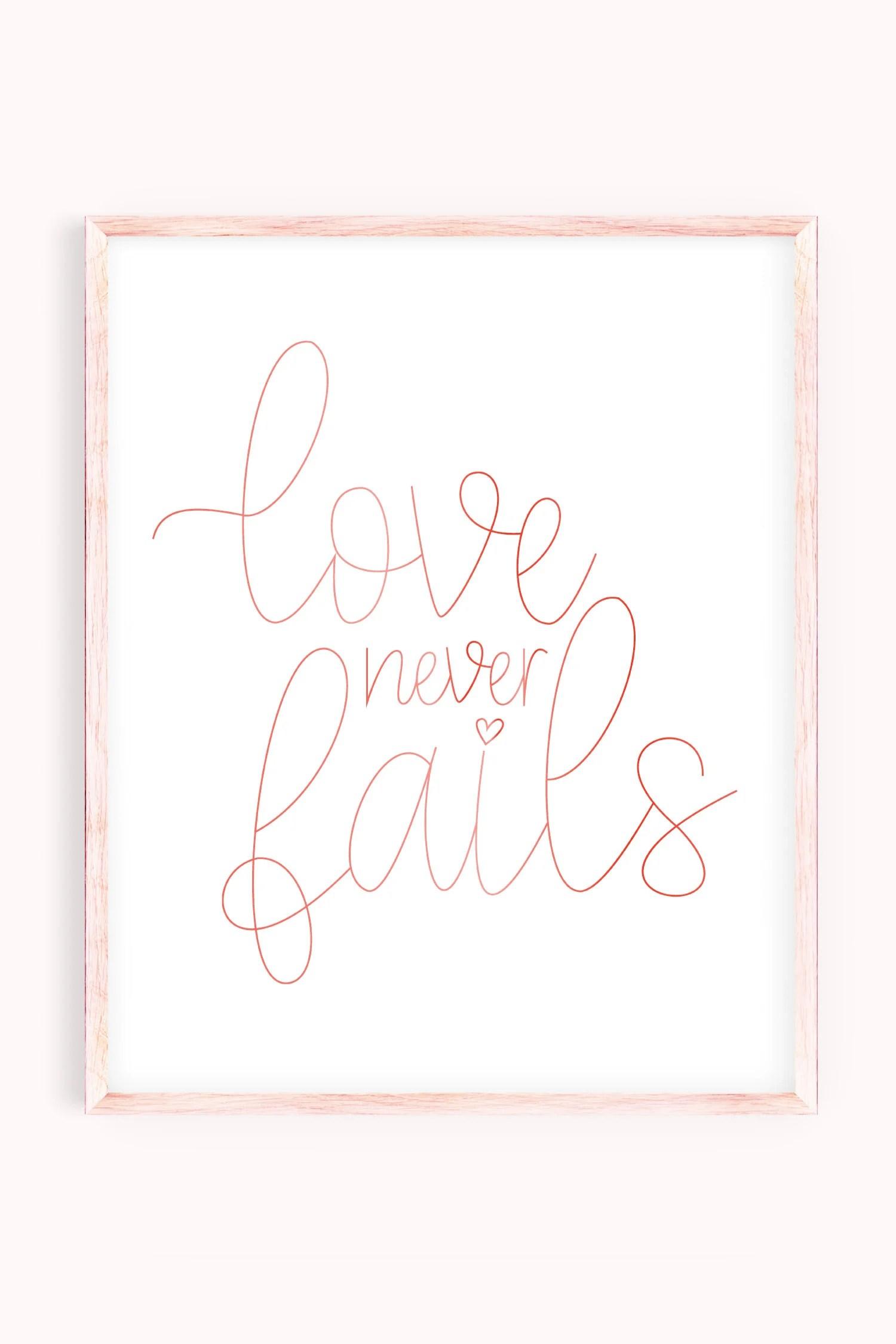 Love Never Fails artwork in pink frame