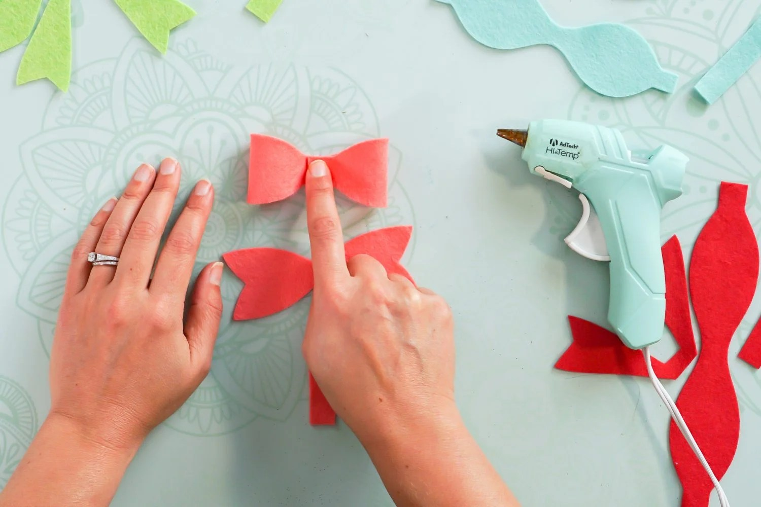 Hands gluing the bow piece together