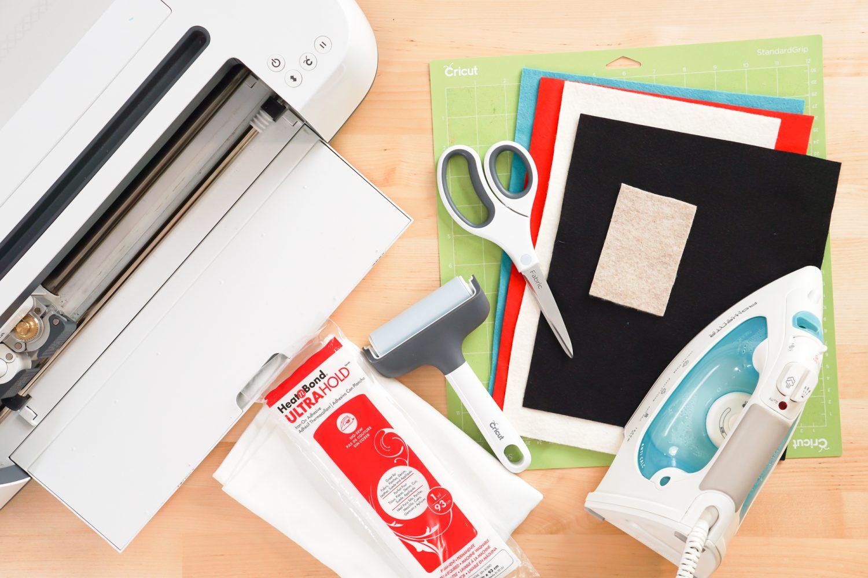 Supplies: Cricut Maker, green Cricut mat, felt, scissors, iron, brayer, pillow case, HeatnBond.