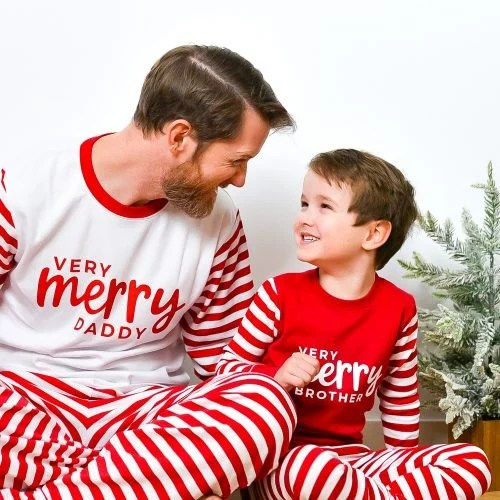 Boys wearing Very Merry Brother shirts and dad wearing Very Merry Daddy shirt