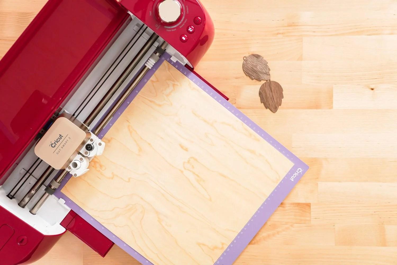Cricut cutting veneer.