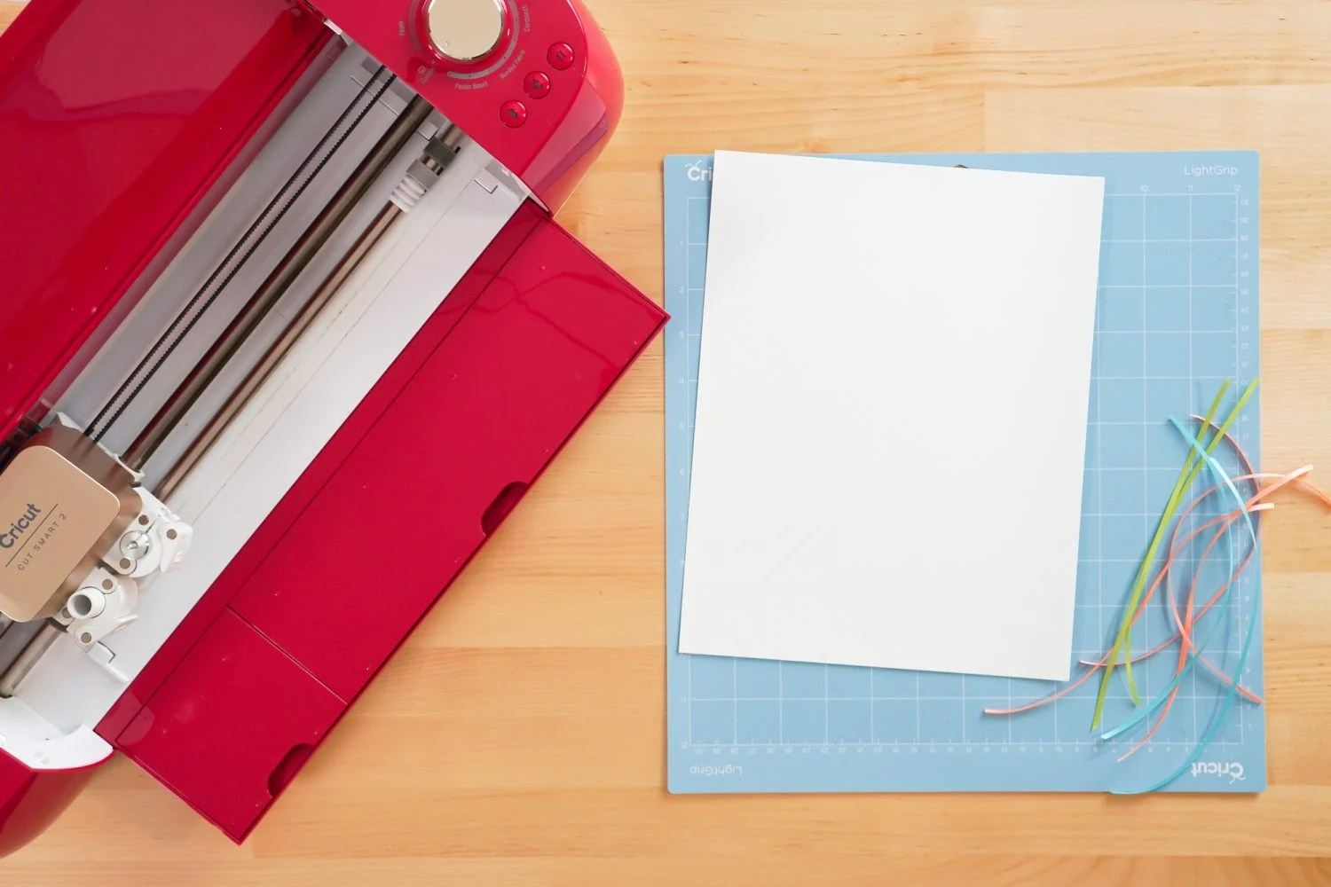 Supplies needed for this project: Cricut, Cricut mat, white cardstock, ribbon