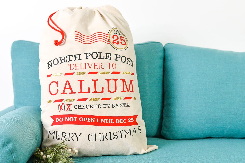 Final Christmas Santa Sack on Blue Couch