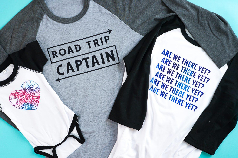 Three Cricut Infusible Ink raglan shirts on teal background.