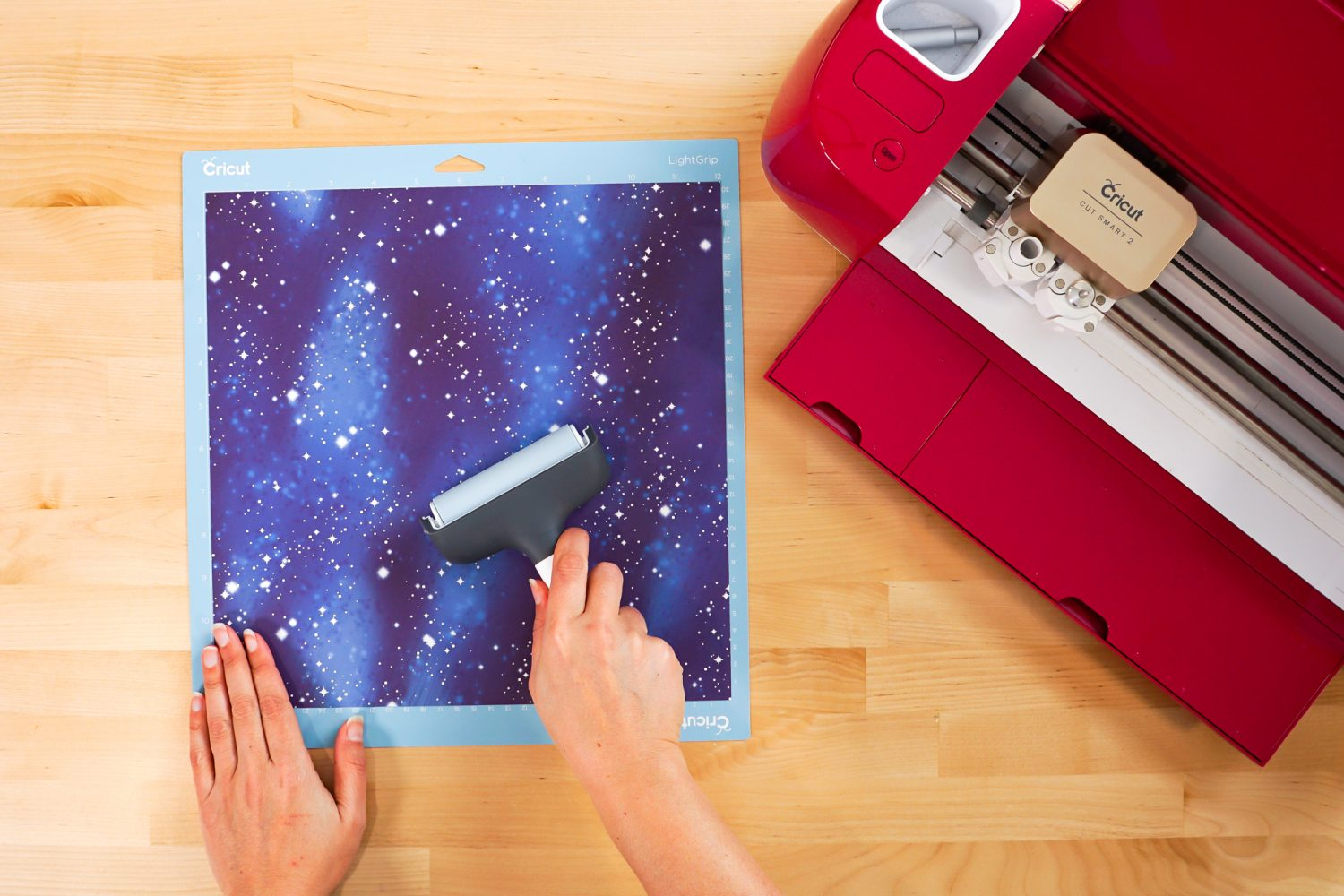 Use a brayer to press down the transfer sheet on the mat