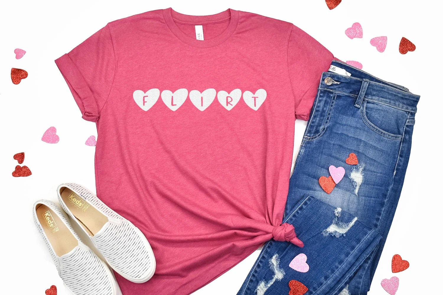 """Pink shirt with """"flirt"""" in heart letters"""