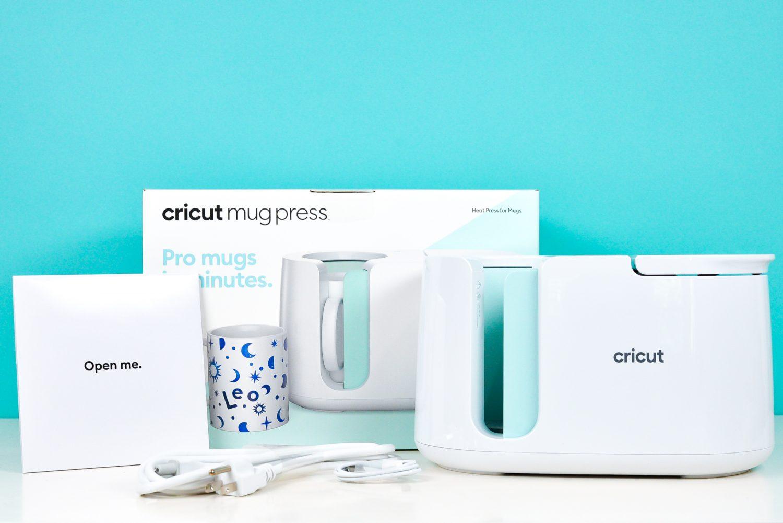 Cricut Mug Press box, press, cables, and quick start guide