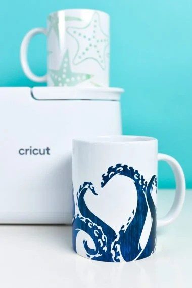 Cricut Mug Press with two sea-themed mugs