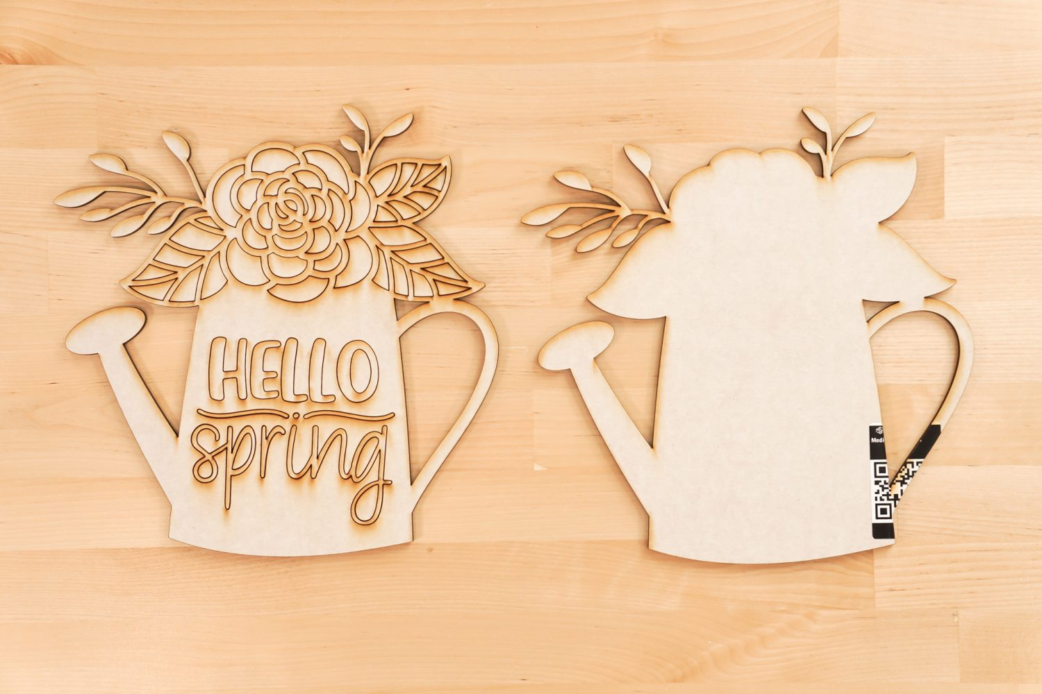 Pieces of the Hello Spring file cut on the Glowforge
