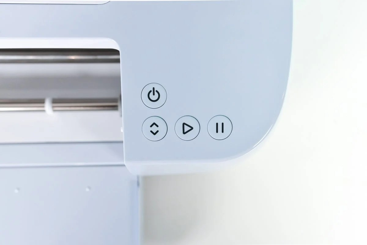 Top-down view of Cricut Maker 3's buttons: power, insert, play, pause.