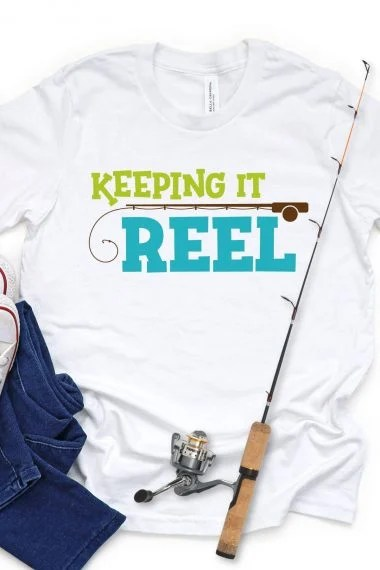 Keeping it Reel SVG on White Shirt with jeans and fishing rod