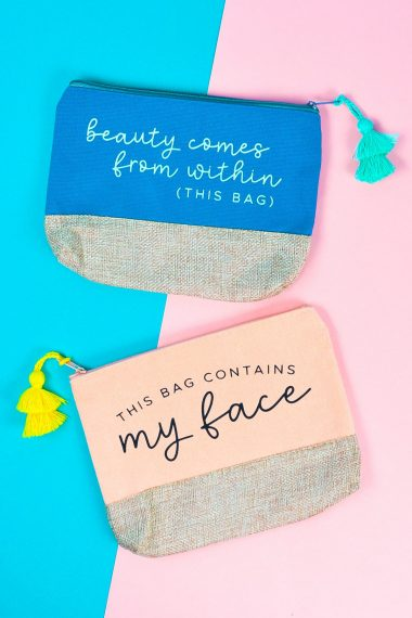 """Finished makeup bags (""""beauty comes from within (this bag)"""" and """"this bag contains my face"""" on a pink and blue background."""