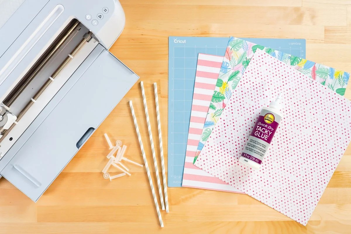 Supplies needed: Cricut, pinwheel accessories, paper, glue, blue mat