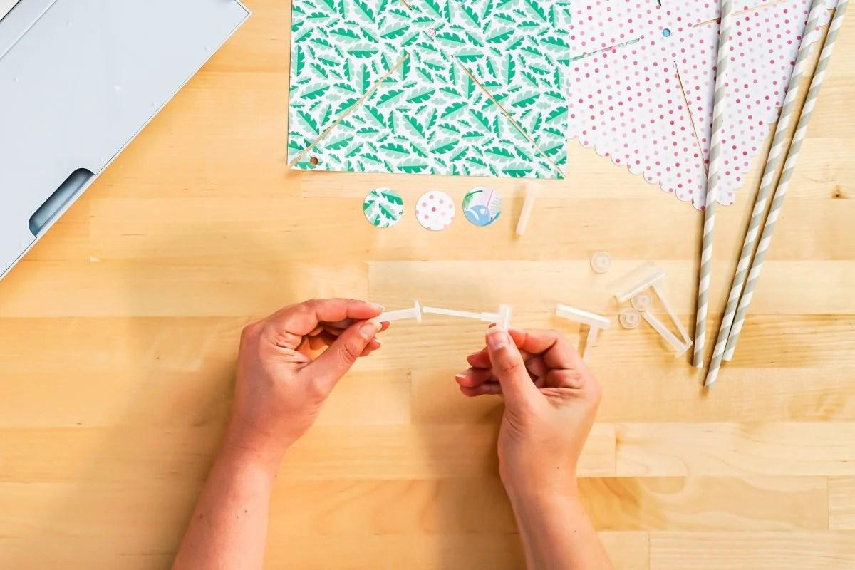 Hands assembling pinwheel accessory