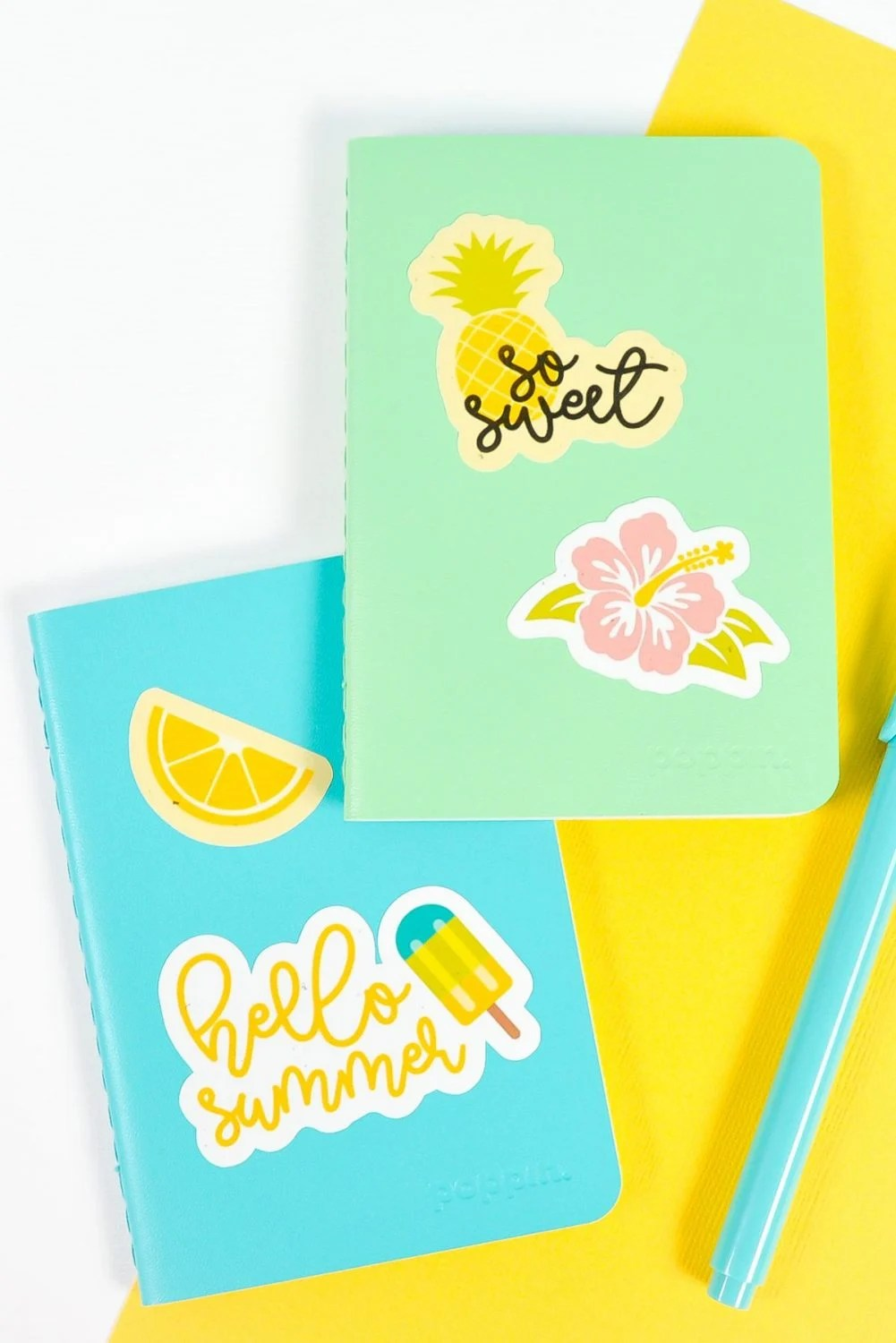 Blue and green notebooks with Cricut summer stickers on white and yellow background