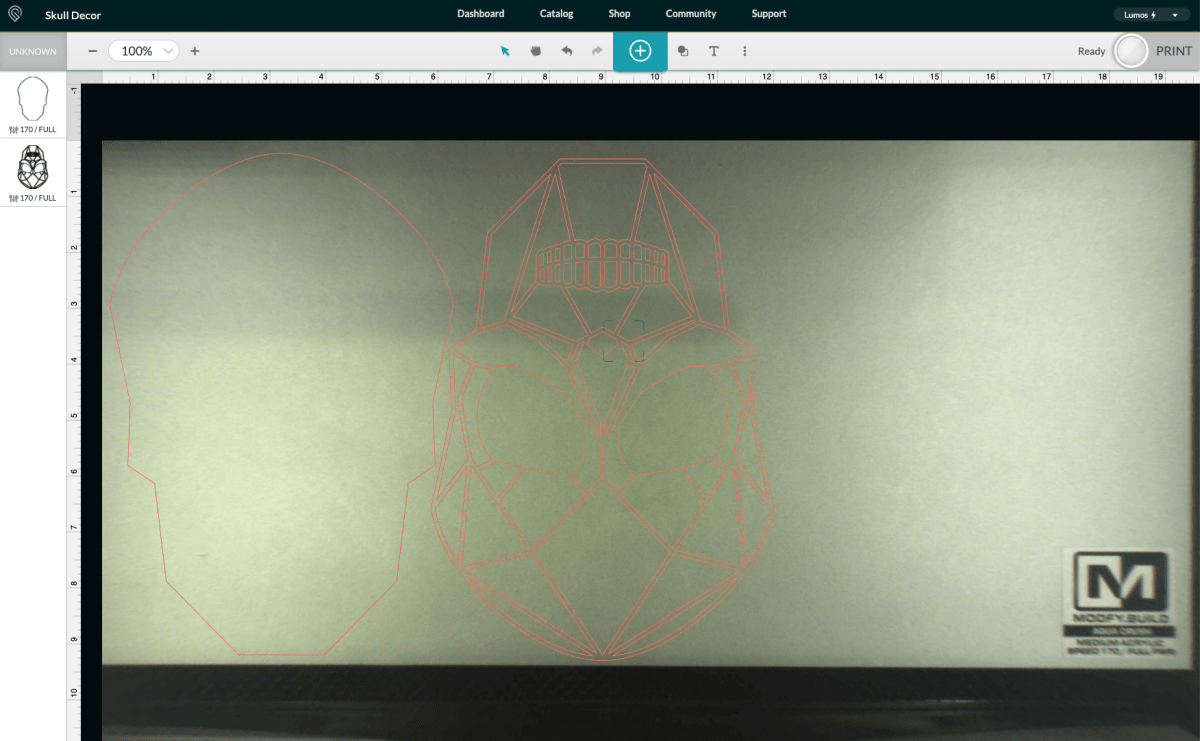 Glowforge app: showing skull rotated and nested.