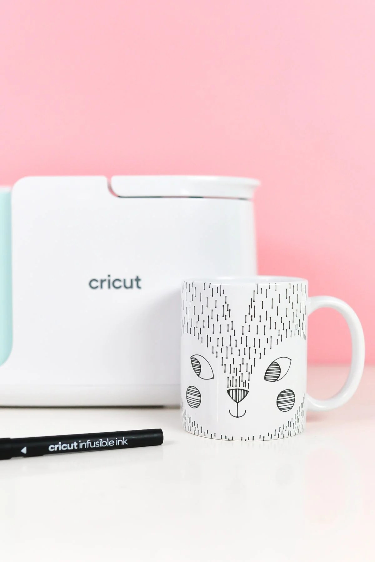 Final skunk mug using pens with Mug Press on pink background