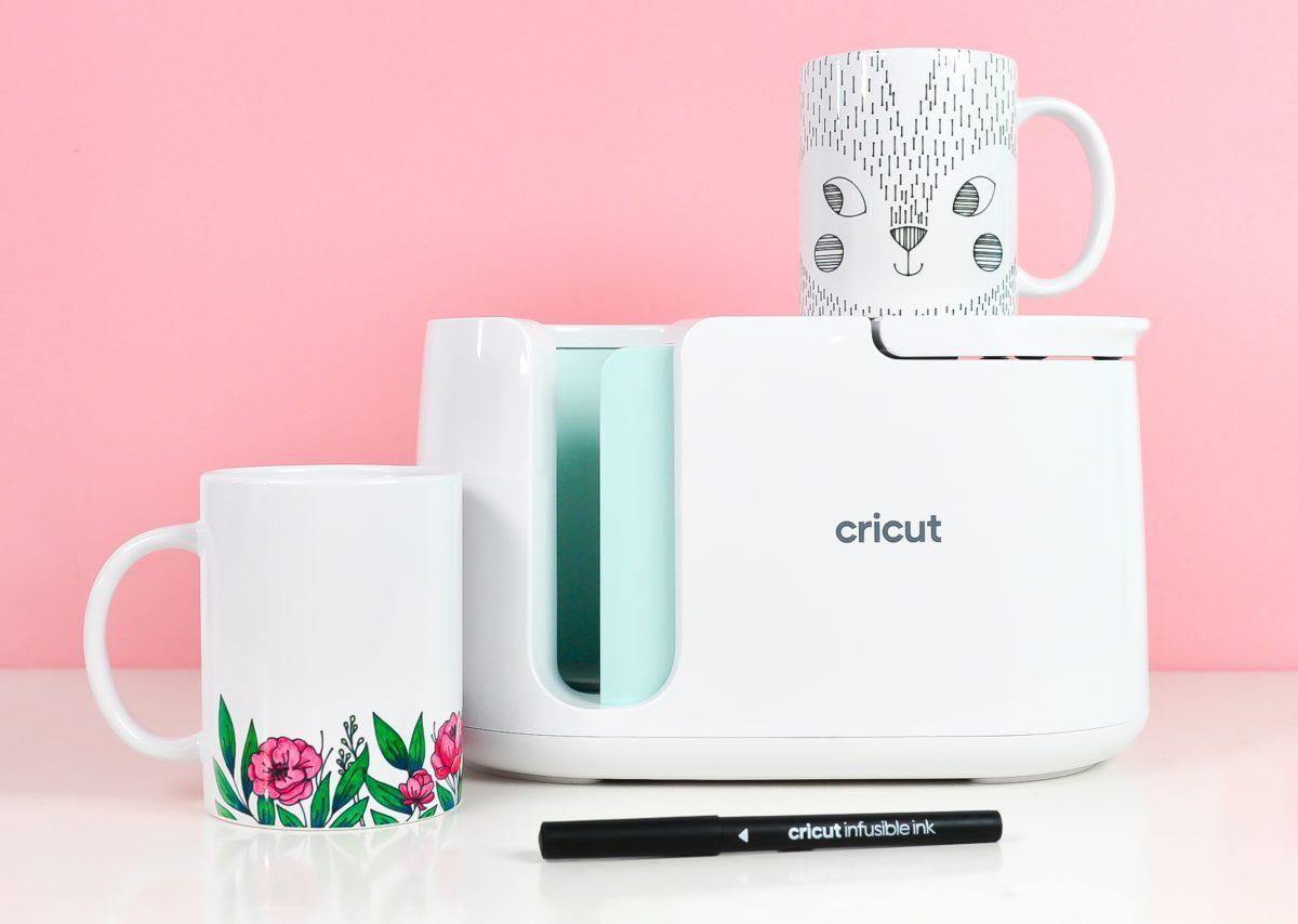 Final mugs using pens with Mug Press on pink background