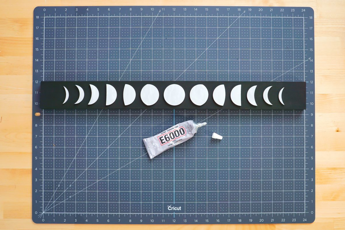 E6000 glue and moon pieces on board.