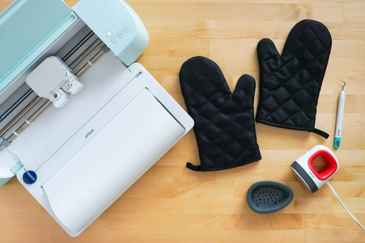 Supplies needed for this project: Cricut Explore 3, oven mitts, EasyPress Mini, weeding hook.