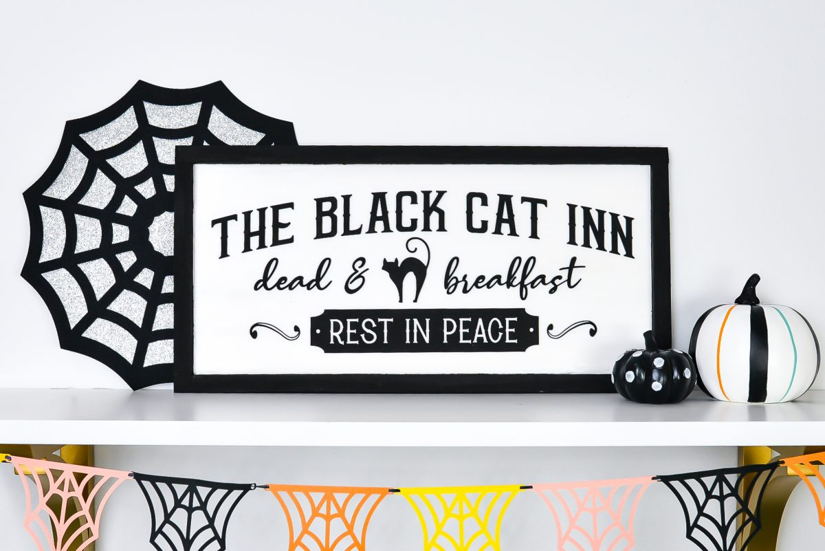 Vintage Halloween Sign: Black Cat Inn sign styled on shelf with Halloween decor