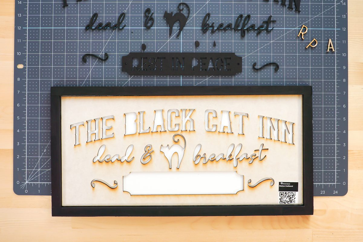 Painted frame with sign stencil inside the frame.