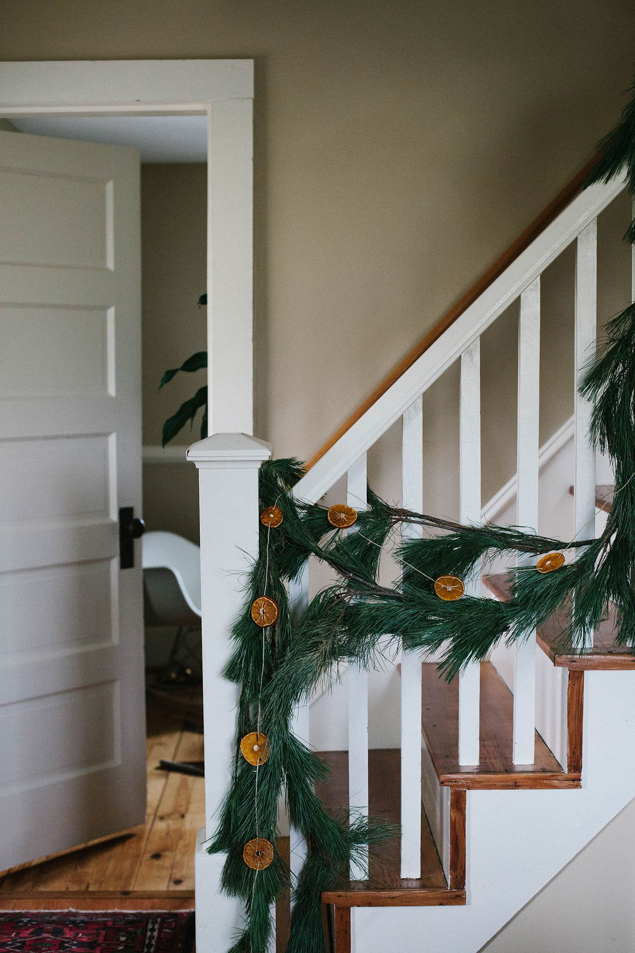 25 Winter Decorating Ideas   How to Decorate Your Home for Winter evergreen garland  dried orange slice garland  winter decorations