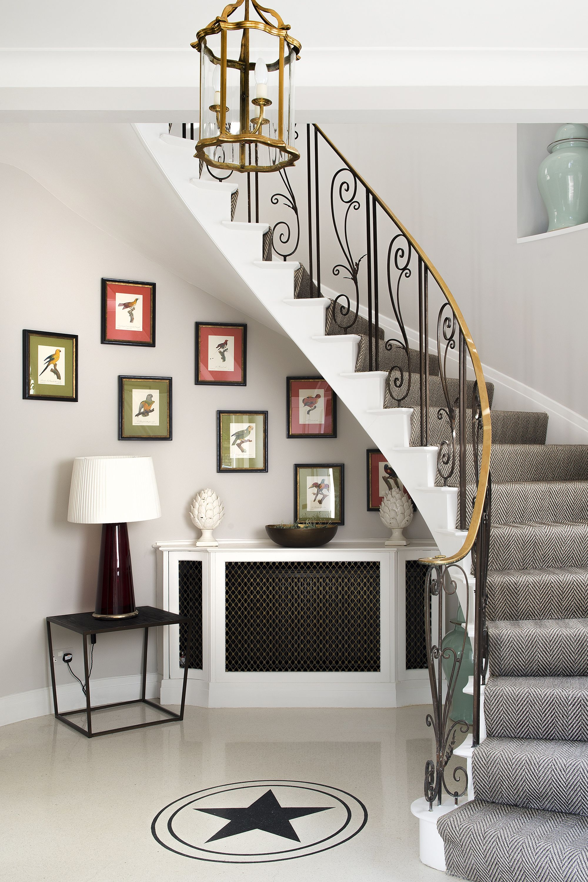 27 Stylish Staircase Decorating Ideas How To Decorate Stairways | Interior Steps Design For Hall | Modern Drawing Room Tv Cabinet | Decorative | Architecture | Half Circle Staircase | Model House Hall