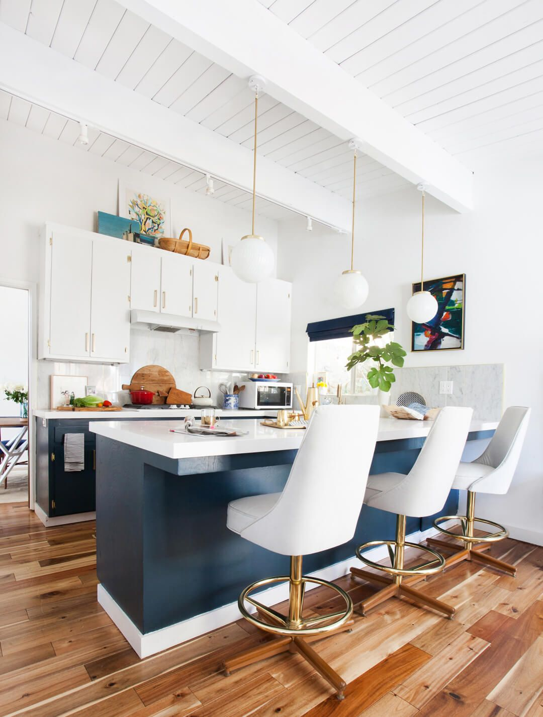 14 Ideas for Decorating Space Above Kitchen Cabinets   How to Design     Courtesy of Tessa Neustadt for Emily Henderson Designs