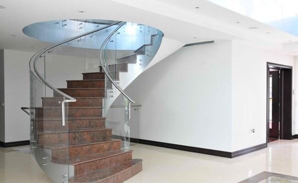 15 Concrete Interior Staircase Designs Home Design Lover | Semi Spiral Staircase Design | Handrail | Inside | Semi Circular | Elegant | Residential Library