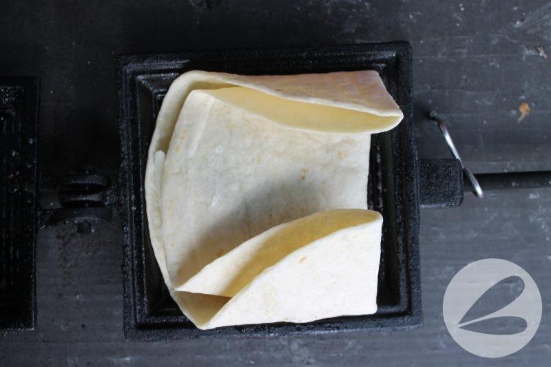 Pie Iron Chicken Pesto Pockets