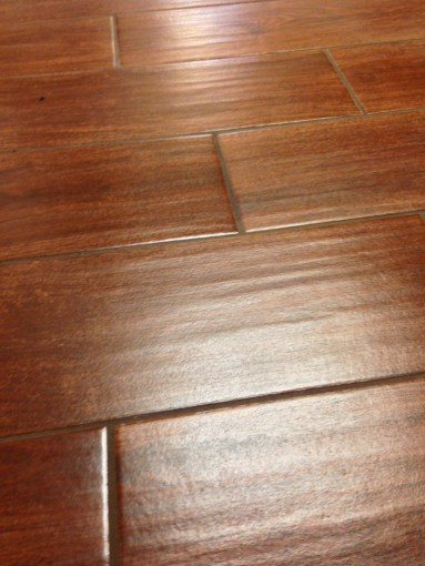 Tile look wood Reviews  A New Reference in Flooring Industry   HomesFeed dark brown tiles look wood ideas