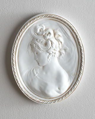 Wall Decor adds French style and texture  Art and sconces from     Cameo Plaque
