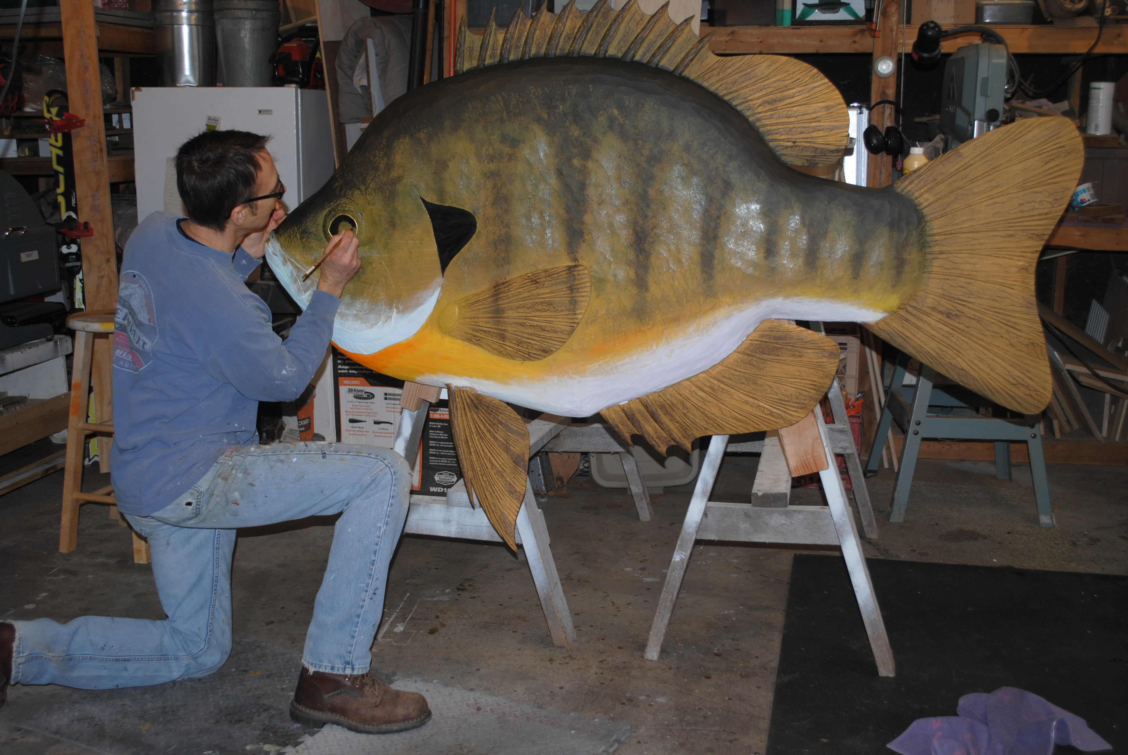 Big Fish Wood Carver Enjoys Fishing For Those Fish He