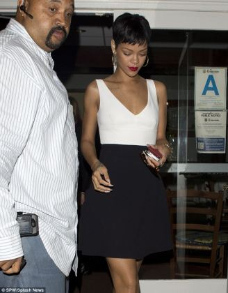 Rihanna swaps up her look AGAIN as she heads for dinner in LA     Lady like  Rihanna wore a black and white dress with a splash of red  lipstick