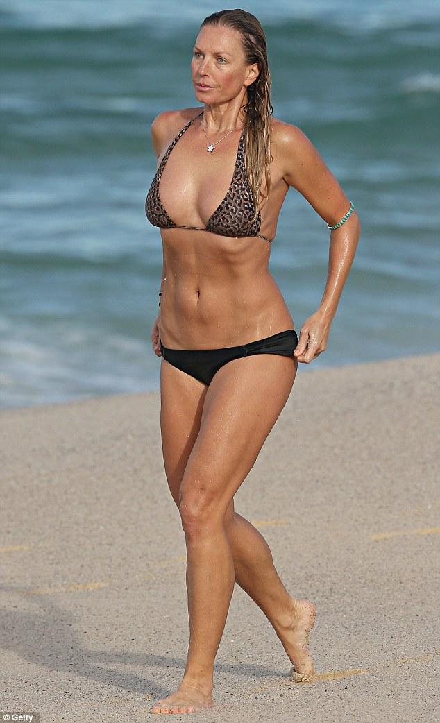 Annalise Braakensiek hits the beach in a leopard print ...