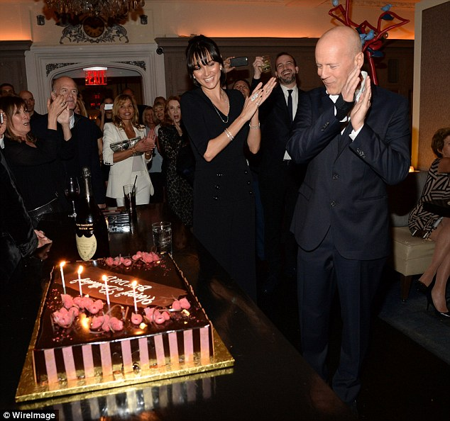Bruce Willis Gets Kisses From Wife Emma On His 60th
