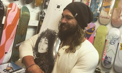 Jason Momoa shows off biceps as he hugs deck with wife Lisa Bonet's face on it | Daily Mail Online