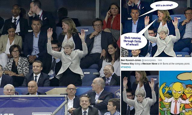 Theresa May Takes Part In A Very Awkward Mexican Wave